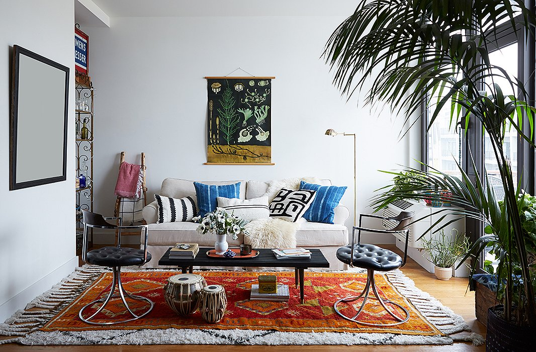 Whether in the form of rugs or textiles, extra layers are the perfect way to channel the lush bohemian look. Photo by Manuel Rodriguez.