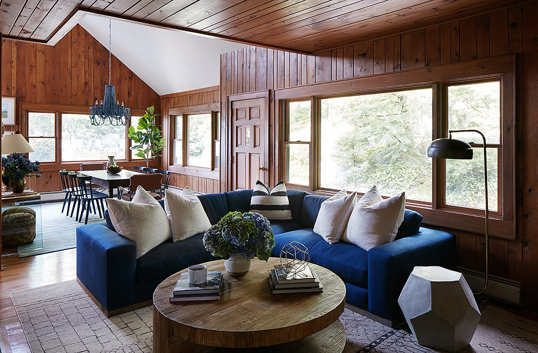 The color palette of rich blues continues into the adjacent movie room, where the family gathers for screenings or to sit around the fireplace during cooler months. Here it was all about soft textiles and cozy textures, from the Moroccan rug to the plush sectional. Find the side table here.