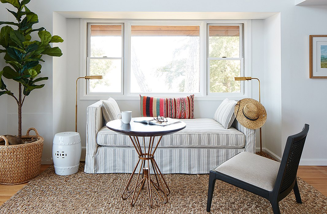 The Shaw daybed performs double duty as an area for morning coffee and an extra sleeping spot. The garden stool serves as a petite nightstand or a place to rest a book. Find the adjustable floor lamps here.