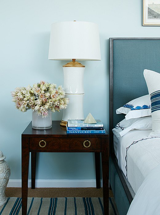 The nightstands and the porcelain table lamps bring a bit of traditional style into the space. Nicole tucked ginger jars nearby to add another classic design element.