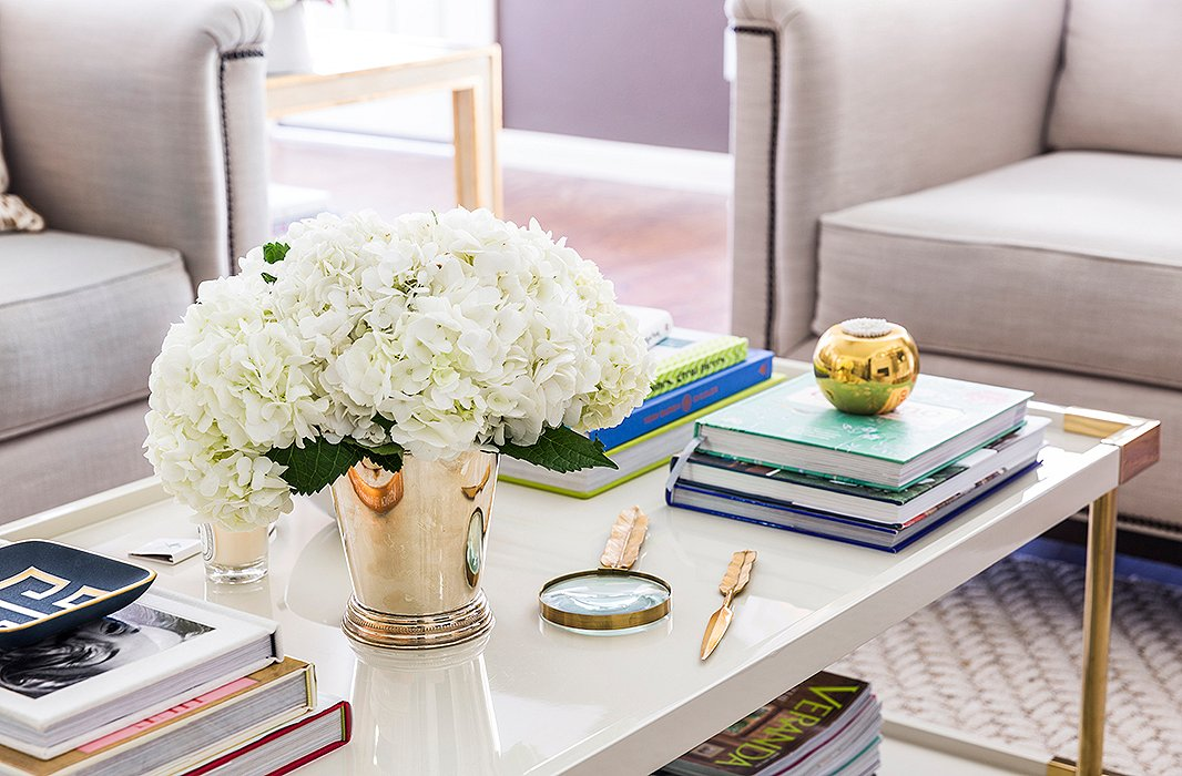 """I love this [Bernhardt] coffee table. The contrast of the cream lacquer and brass hardware is really beautiful,"" says Paloma. Her styling tip? ""I think a good mix of books, a few carefully chosen accessories, and fresh flowers are always a winning combination."""