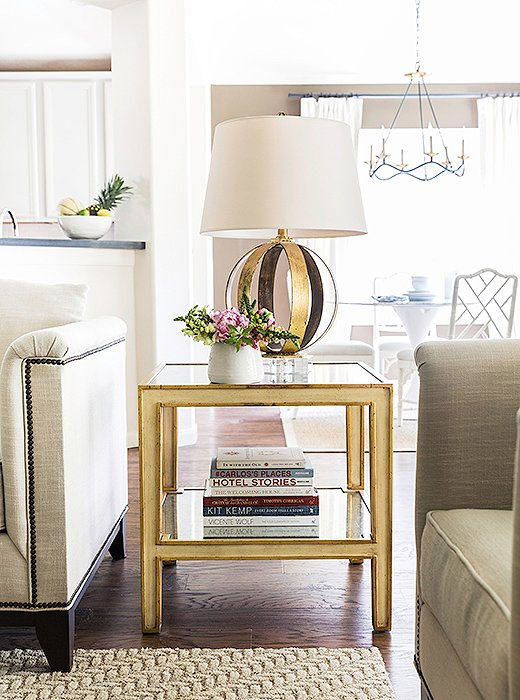 "The gilded side table and lamp add some glamour to the tonal space. Paloma loves using fresh-cut flowers of all kinds. ""Peonies, hydrangeas, and roses are my favorites. But I also love potted orchids, which last longer and look beautiful."""
