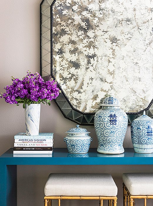 "An unexpected major style moment in the master bedroom comes courtesy of a Karl Springer Parsons table. ""It's from the early '70s,"" says Paloma. Originally lime green, the console has had many color incarnations. ""I chose this peacock blue because I was really inspired by it at the time. And I still love it."""
