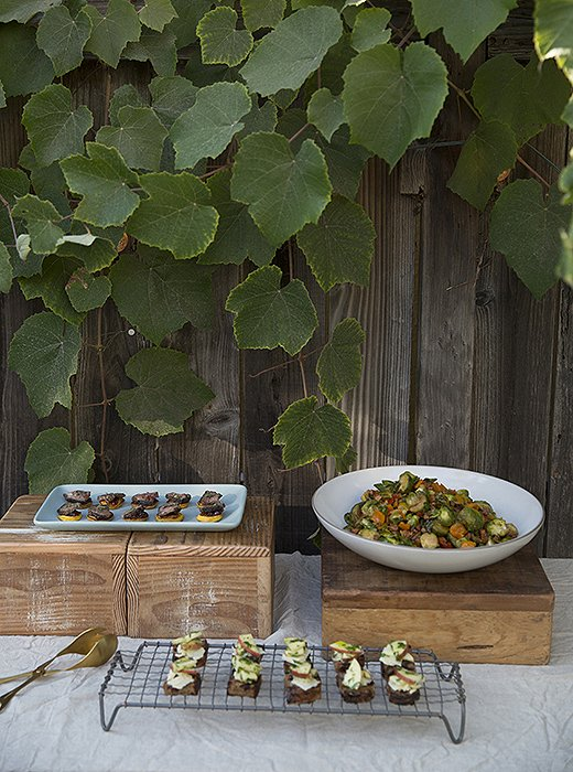 From flowers to decor to party food, Whitney likes a natural vibe. Here, appetizers are displayed on vintage wooden boxes and a wire cooling rack.