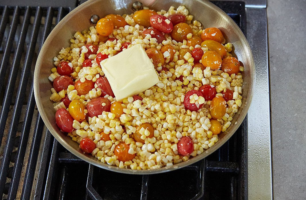 Destined to be the base for our fish: a rustic tomato-and-corn mishmash that delivers that very summery buttery corn-on-the-cob taste.