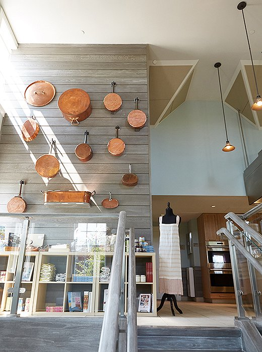 The Nantucket Looms chose a gray wash over reclaimed oak, along with a collection of antique and new copper pots, for the staircase leading up to the Culinary Center's top floor, where many cooking classes are held.