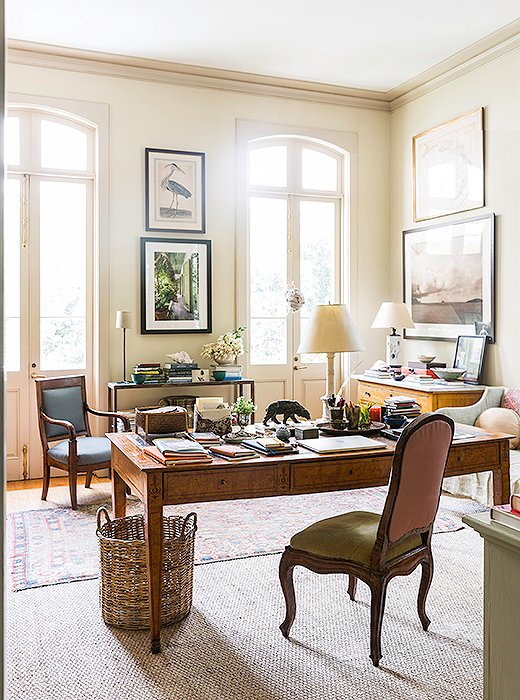 Columns and a pair of sea-grass mats divide Julia's office area from her sitting area. She's layered the natural-fiber rugs with antique Oriental rugs and an unusual striped dhurrie, which she bought from her friend Suzanne Rheinstein's Los Angeles store, Hollyhock.