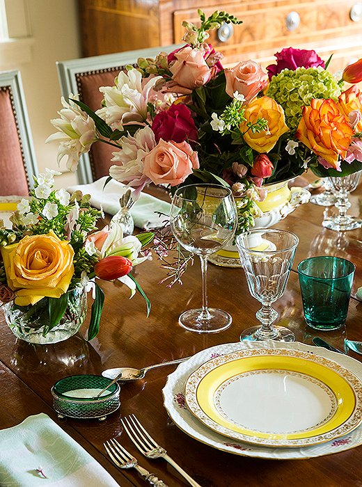 "Vibrant and polished, Julia's impeccably set dinner table beautifully represents her affinity for the high-low mix. ""I'll use heavy 19th-century French wine goblets from Lucullus [a favorite antiques store in the French Quarter] with thin water glasses, sometimes in color, from, say, CB2."""