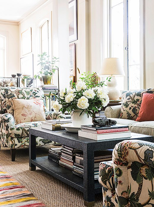 "Julia upholstered a pair of large armchairs in her more casual living room in her favorite crewelwork fabric. ""I'm mad for the Bennison linen that covers that pair of chairs,"" she says. ""I carried a swatch of that linen around for 20 years until I had a house that was right for it and a place to use it."""