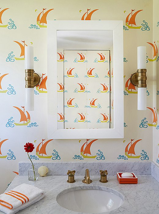 "A small bathroom space provides the perfect opportunity to go a little wild—and Katie Ridder's Betelecat wallpaper is as fun as its name. The nautical motif is in full force here, but as usual, Elizabeth put her own spin on it. ""I didn't want to just do the traditional blue and white—sometimes I feel like that's all I see here. I needed something a little different!"""