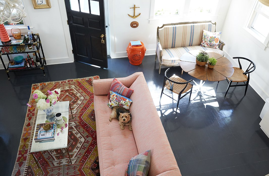 """The dark floors contrast perfectly with Elizabeth's more upbeat choices (""""I do love color, and I do love pattern,"""" she admits). Overall the decorator took her design cues from the seaside location, making sure to nail that """"old Nantucket spirit"""" without being overly reverential. """"These are the original floors,"""" she notes. """"We were going to rip them out but instead decided to sand them down and paint them a historical gray."""""""