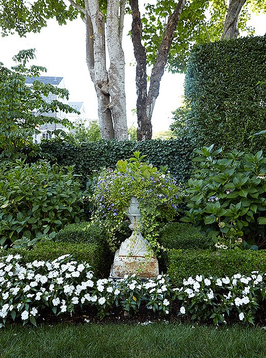 "The flower-filled garden connects Elizabeth's abode to her parents' main house. And it's her parents, at least partially, she has to thank for her career. ""I worked for an interior designer here in the summers when I was growing up,"" she recalls. ""My parents said, 'You have to get a job!' and my mom helped find it for me. At first I hated it, but when the next summer came around, I went back. I stayed with it, and I ended up really loving it."""