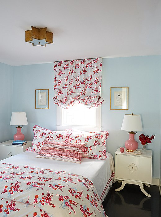 "Cheery D. Porthault linens give daughter Mary Jane's room its fanciful flair. To make the most of the print, Elizabeth had balloon shades made to match. The ceiling fixture (almost identical to the Sophia Flush Mount) and the powder-blue walls keep the space from feeling excessively frilly. ""The fixture is almost like something that could be in a '50s diner,"" notes the designer. ""But when you take it out of that context, it becomes almost nautical."""