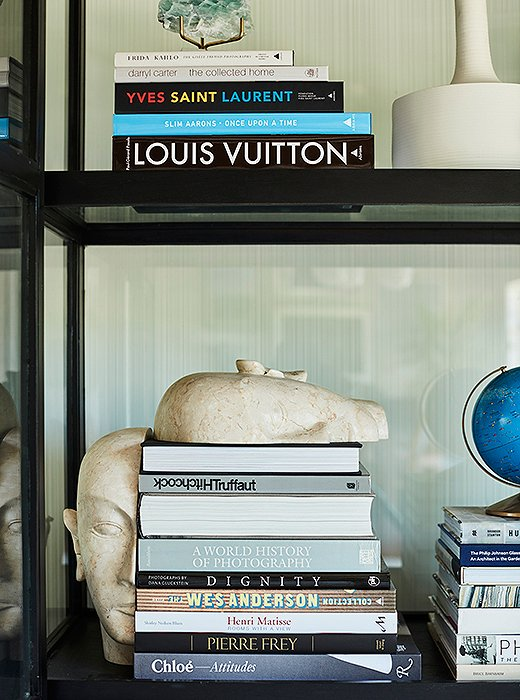 The glass cabinet invites the eye to wander over Sophia's collection of globes and other curios along with her mini library of coffee table books.