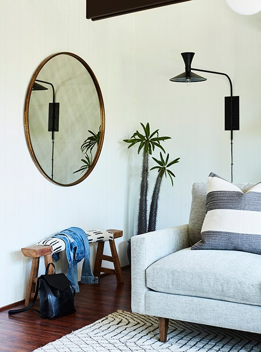 The house is on the tiny side—the front door opens right up into this main room.A rough-hewn wood bench gives it a bit of bohemian Bolinas spirit to set the tone.