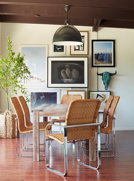 "The lack of a rug plays up the wicker-and-chrome dining chairs, which Alex calls ""such standouts."""