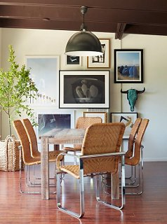 The Lack Of A Rug Plays Up The Wicker And Chrome Dining Chairs,