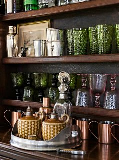 The Bar Displays Colorful Vintage Glassware, Copper Mugs, And Julep Cups  From Family Christenings