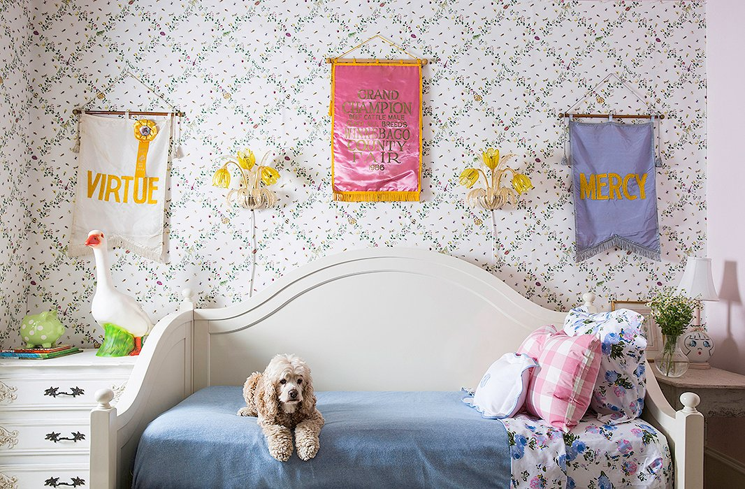 """I love all of the collections of items from my childhood mixed with our vintage finds,"" says Bailey. ""In Grace's room there are some vintage flags I found at the Round Top Antiques Fair, as well as some framed Peter Rabbit etchings that were in my nursery."""