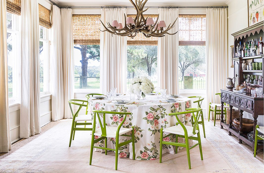 "The round table is perfect for a crowd but doesn't feel overwhelming when it's just the family of four. ""When you have a long skinny table, it just feels empty, whereas with a round table you can just keep squeezing people as more come,"" Bailey notes. It took her a while to come around to the antler chandelier, which was left by the previous owners. ""Once I got everything in there together, it just felt fun to me, so I left it."""