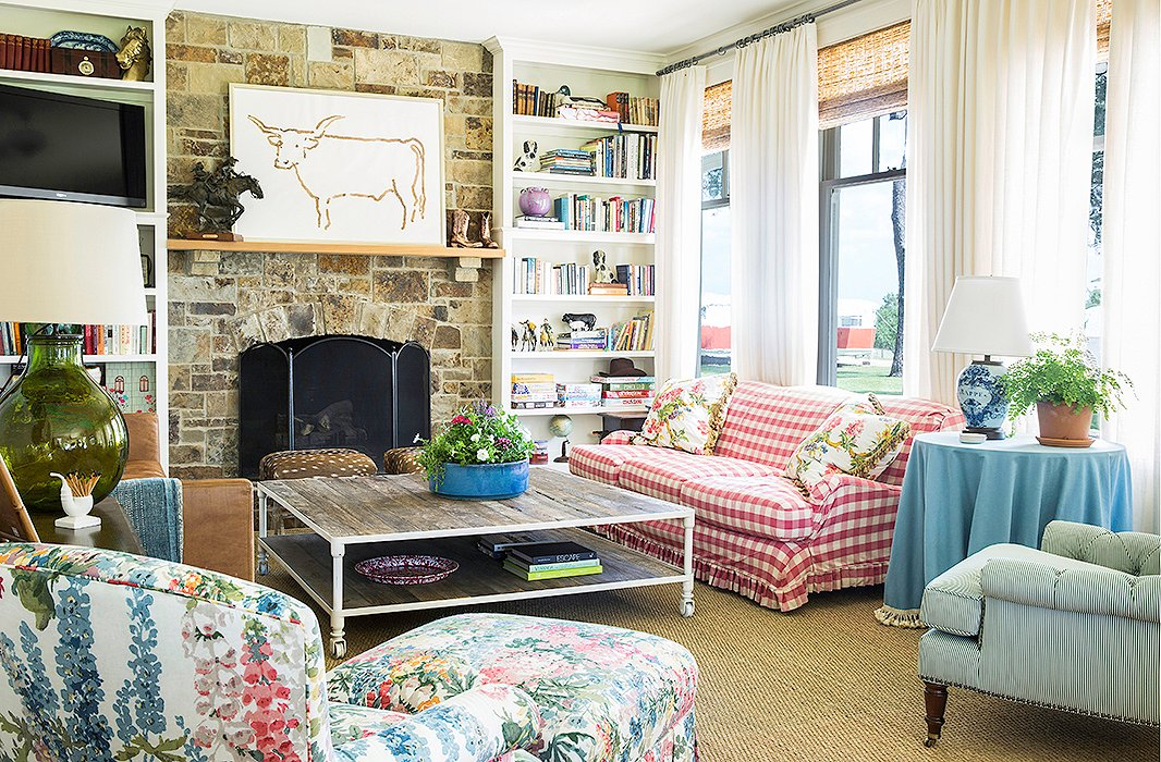 Bailey chose durable pieces for the living room, including an &ldquo;indestructible&rdquo; leather sofa and coffee table and a sofa slipcovered in a pink check. &ldquo;Chintz and mixed patterns are great for hiding stains,&rdquo; she says. Even the vintage toys and games fit the casual country vibe. &ldquo;I think they are charming, so we keep them out on the shelves where the kids can easily access them&#8212;and put them away as well!&rdquo;<br />