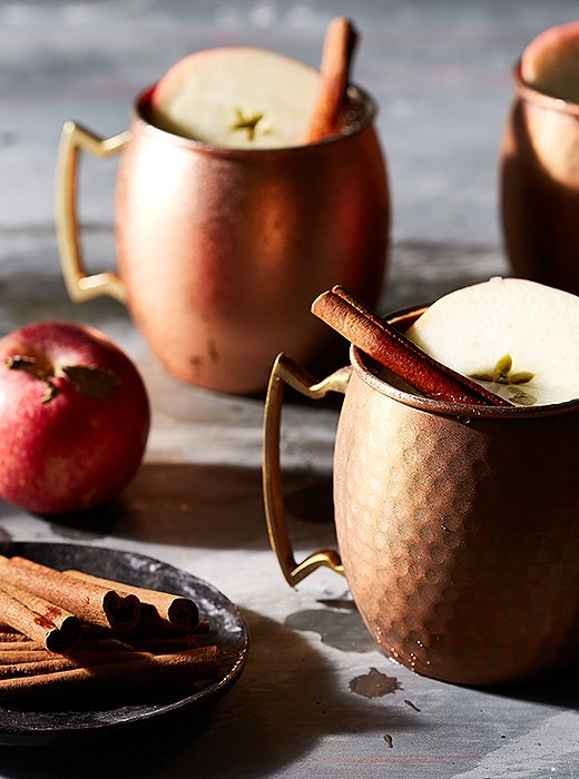 Garnished with an apple slice and a cinnamon stick, these apple cider Moscow mules taste as good as they look.