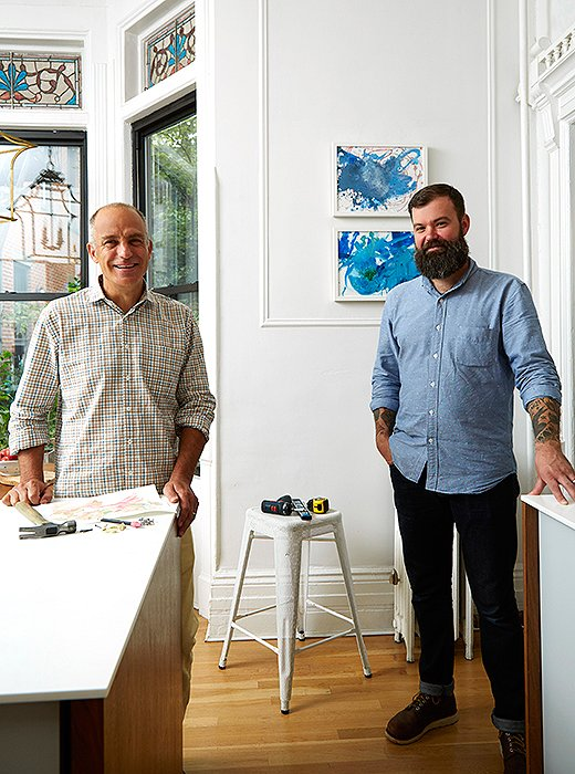 David Kassel and Chris Deo of ILevel, fresh off hanging the pair of toddler paintings behind them.