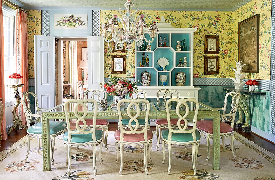 "The dining room is an homage to Bar Longhi at the Gritti Palace hotel in Venice. ""You sit in that bar and you feel like you've been whisked away to this magical world,"" Jason says. ""We wanted to recreate that experience in our own home."" The designers mixed a Murano glass chandelier and antique floral plasterwork with a glass-top table and chairs from eBay for an elegant but approachable space. ""It's a more formal dining room, but it's a glass-top table, so nothing feels stuffy,"" says John."
