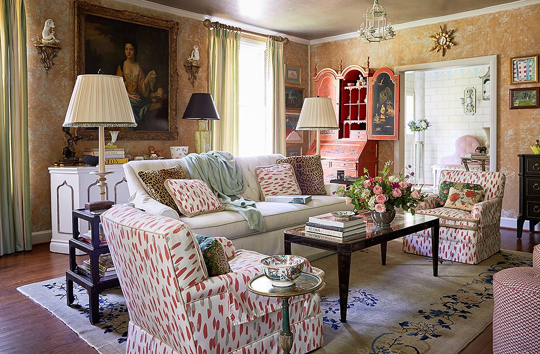 "The living room gets used daily and was inspired by a design that iconic decorator Elsie de Wolfe created in Beverly Hills. The treatment was a happy accident. While stripping the wallpaper, they discovered that the remnants of the previous papers and original damask created an interesting texture. ""You never know what you're going to discover when you renovate, and if you find something magical, keep it,"" Jason says."