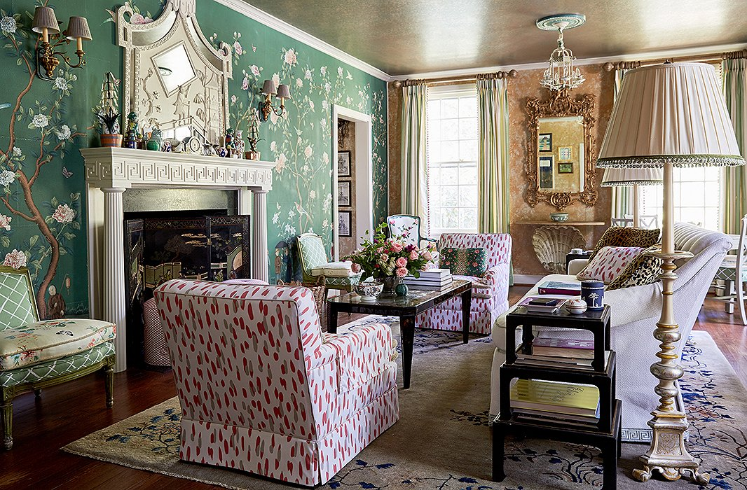 "While the home is filled with classic details, Jason and John customized them to feel personal. For instance, the custom Gracie wallpaper features depictions of the couple's three dogs. They placed a plush sofa and vintage chairs facing the fireplace. ""It's a place you can put your feet up, but it's still a high style."""