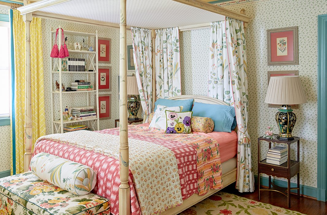 "The designers love pieces with a great backstory. ""Pretty much everything in the house is vintage or antique, and a lot of those pieces come from persons of relative note,"" says Jason. A guest room's canopy bed is from the estate of actress Joan Fontaine."