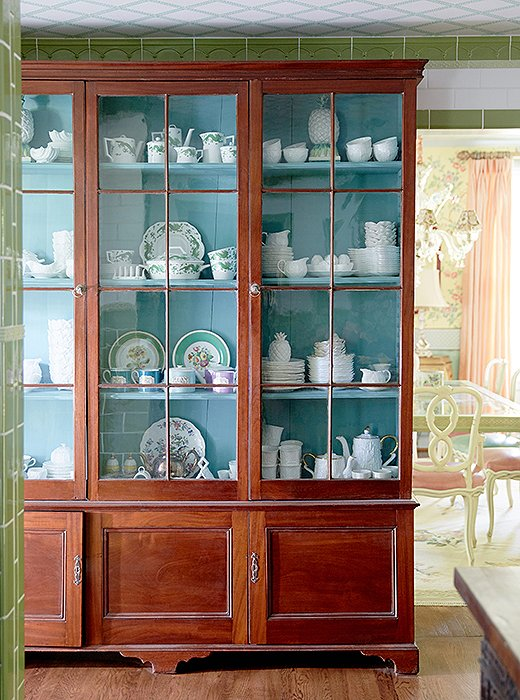 "The designers installed an antique library cabinet to store and display their china. ""It's another great place to show our collection and try things that are right at your fingertips,"" Jason explains."
