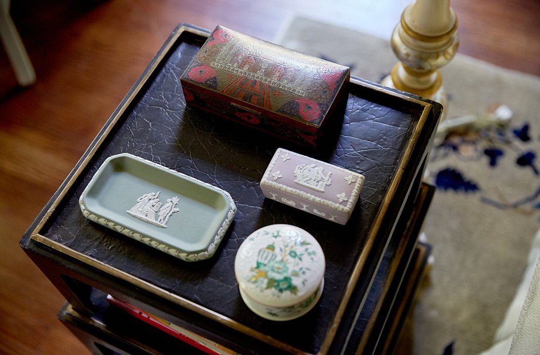 """We love having those little moments,"" says Jason of the collections displayed throughout the house. ""Every little piece that we have is a story from our travels or something that we inherited from our family, and those memories and traditions bring those collections to life."""