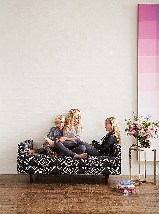 Christiane and kids kick back on a Cloth & Company upholstered daybed.
