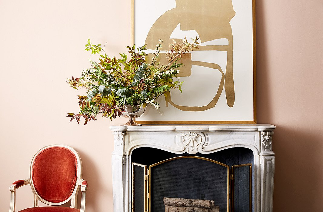 Eucalyptus adds height, cedar adds volume, and forsythia and snowberry add color and texture to this bowl vase's rule-breaking arrangement. Photo by Frank Tribble.