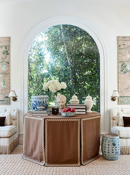 A skirted table, a Chinese garden stool, a Roman-style bust: All are from different periods and provenances, but to the New Traditionalist that doesn't matter. Photo by Joe Schmelzer; design by Mark D. Sikes.