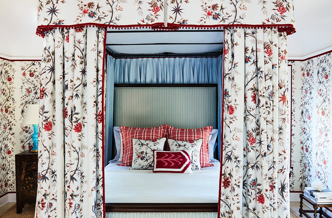 "Scalamandré stripes and pillows dressed in Mark's own fabric finish off the bed. The nightstands are from an antiques store in Sonoma County. The lamps are Christopher Spitzmiller. The designer's guest room checklist? ""Lots of towels, water by the bed, note cards, and something to write with."""