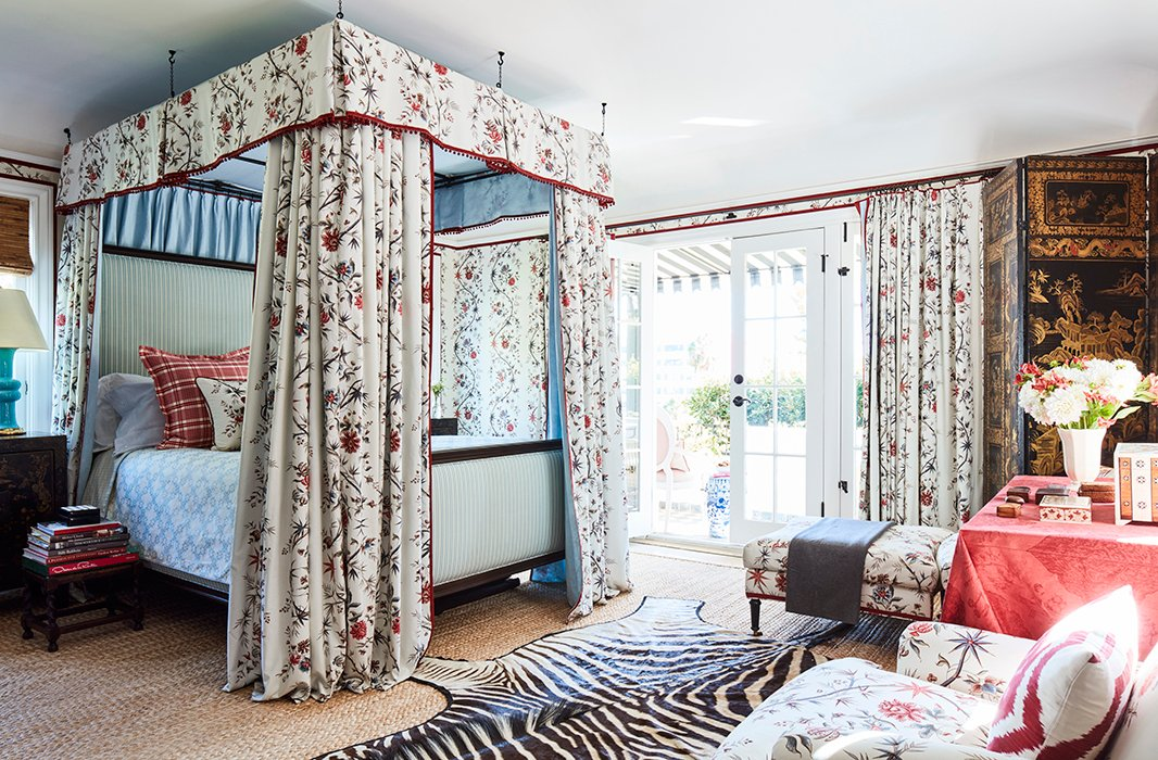 """The guest bedroom feels like a chambre in a French château thanks to the resplendent Pierre Frey Braquenié print. """"I've actually slept in here a few times, and waking up in it is really spectacular,"""" says Mark. """"It's fun and glamorous, but it still has a sense of California ease because of the nature just outside."""""""