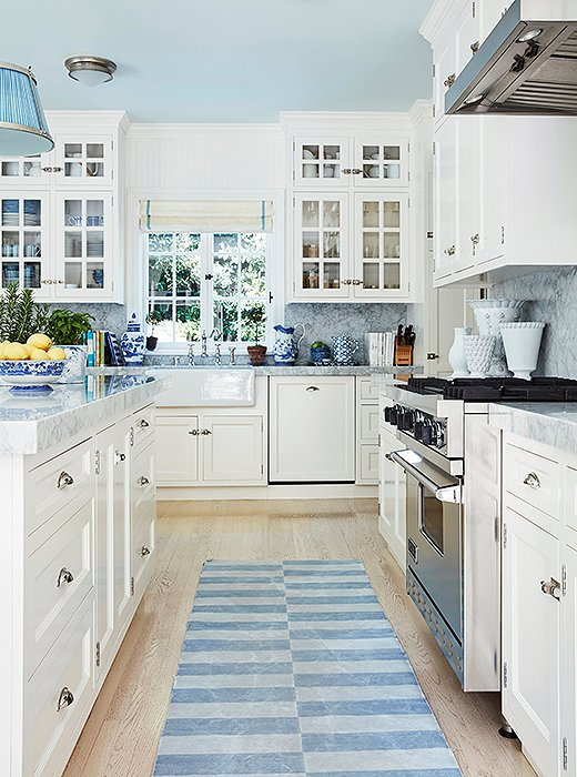 "Shades of blue and white make for a cheerful, crisp kitchen. ""I love blue-and-white dhurries,"" Mark says."