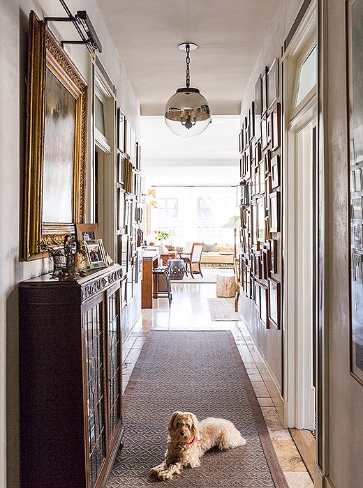 "An antique Dutch oil painting from Katie's childhood home rounds out the hallway, a magnet for guests and visitors (and the family pooch, Noodles). ""People love hanging out there—it's like a little magic zone. It's a trip down memory lane in the best possible way."""