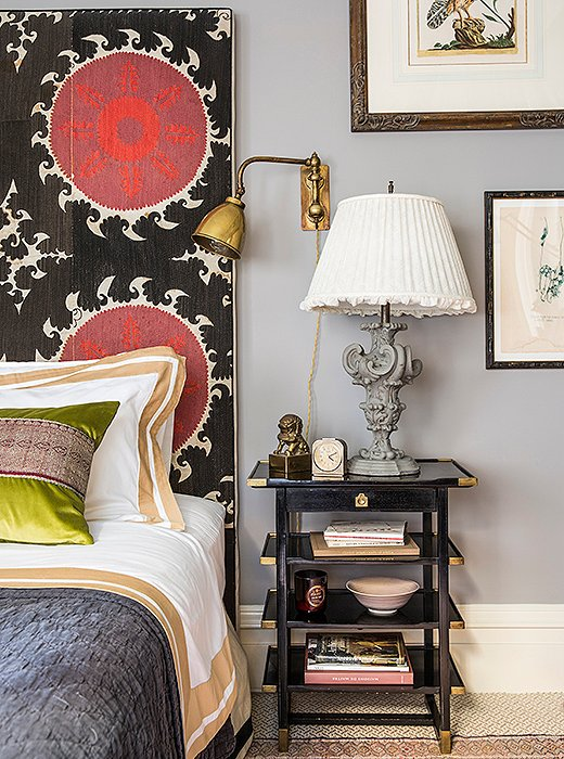 "Unafraid of going big with pattern in a small space, Katie covered her headboard in a large-scale suzani print. ""I find that by giving more definition to spaces through color and pattern you can make something feel a lot bigger than it actually is."""