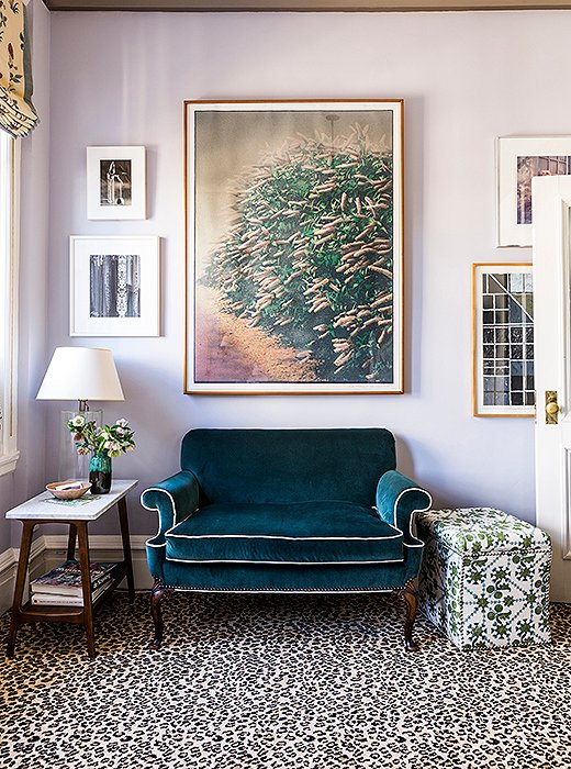 "The velvet-upholstered settee has been with Katie since her 20s and now finds a home in her daughter's room. ""It's been recovered a million times, and this is its latest incarnation,"" she says. Leopard-print carpet adds an unexpected touch of glamour."