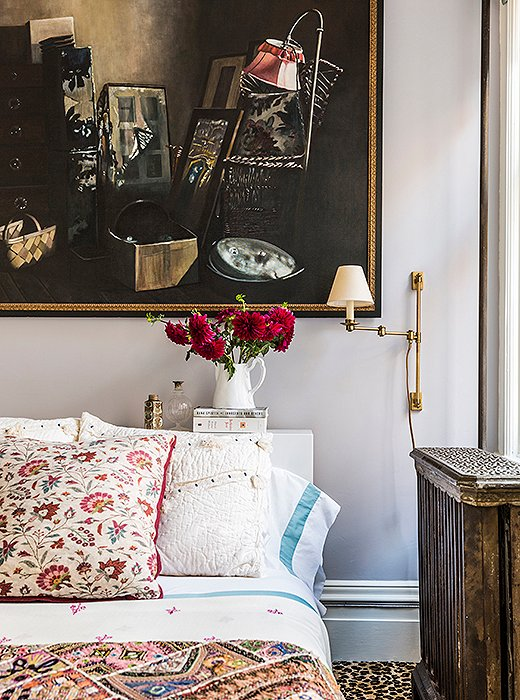 Pillows and quilts in varying patterns and colors feel perfectly mismatched in this eclectic space. Photo by Lesley Unruh.