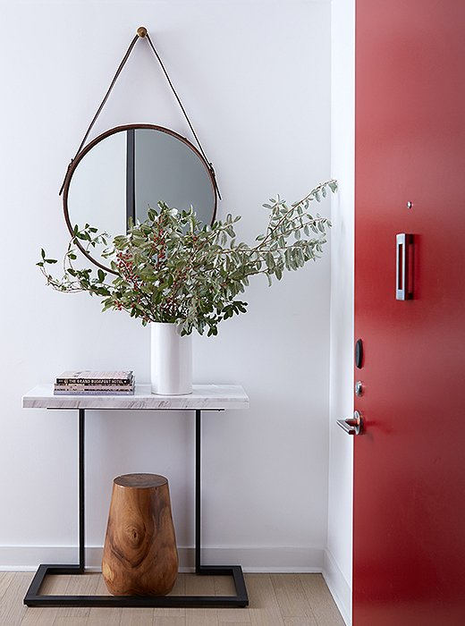 A mirror paired with a few eucalyptus branches makes a statement with mass appeal.