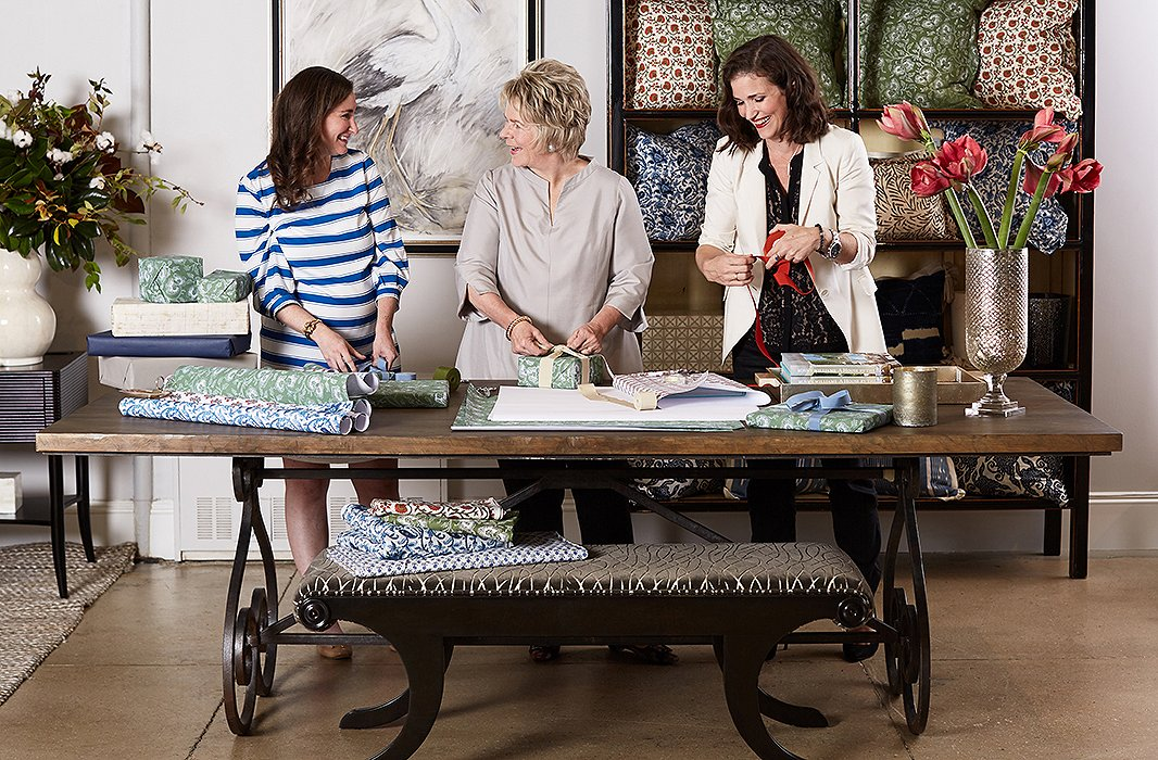 Holiday extends beyond the home for Bunny, who sets a welcoming seasonal tone in her showroom too. And every year, she gets her team in on the wrapping fun for gifts that are at hand when special guests stop in. Here, Bunny enlists the help of her design aides, Audrey Margarite and Jennifer Potter.