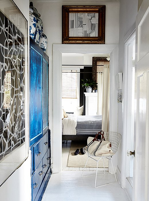 "William painted the hallway's built-in cabinet blue to make it feel more like an armoire. ""It gave that space a purpose and added that statement that you needed in an area that would normally be blasé."""