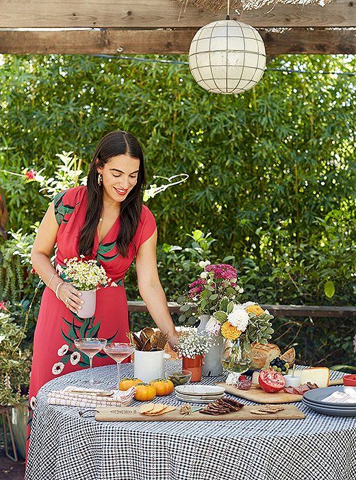 """Heather sets the scene in the outdoor dining area of her Los Angeles home. """"Ilove eating at a circular table,"""" she says. """"I think it's really cozy, and everyone is huddled in and it feels much more intimate than a long dining table."""""""