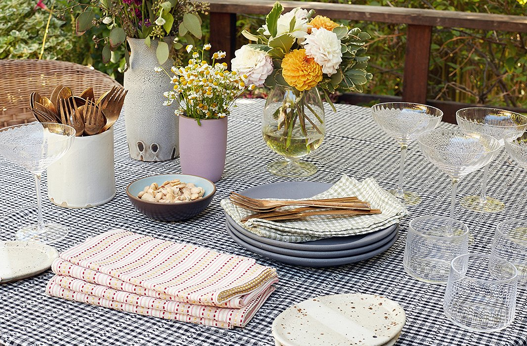 """""""I always have my eye out for new special things that I can add to the table,"""" Heather says. """"I start with linens and put them with whatever is exciting me at the moment."""""""