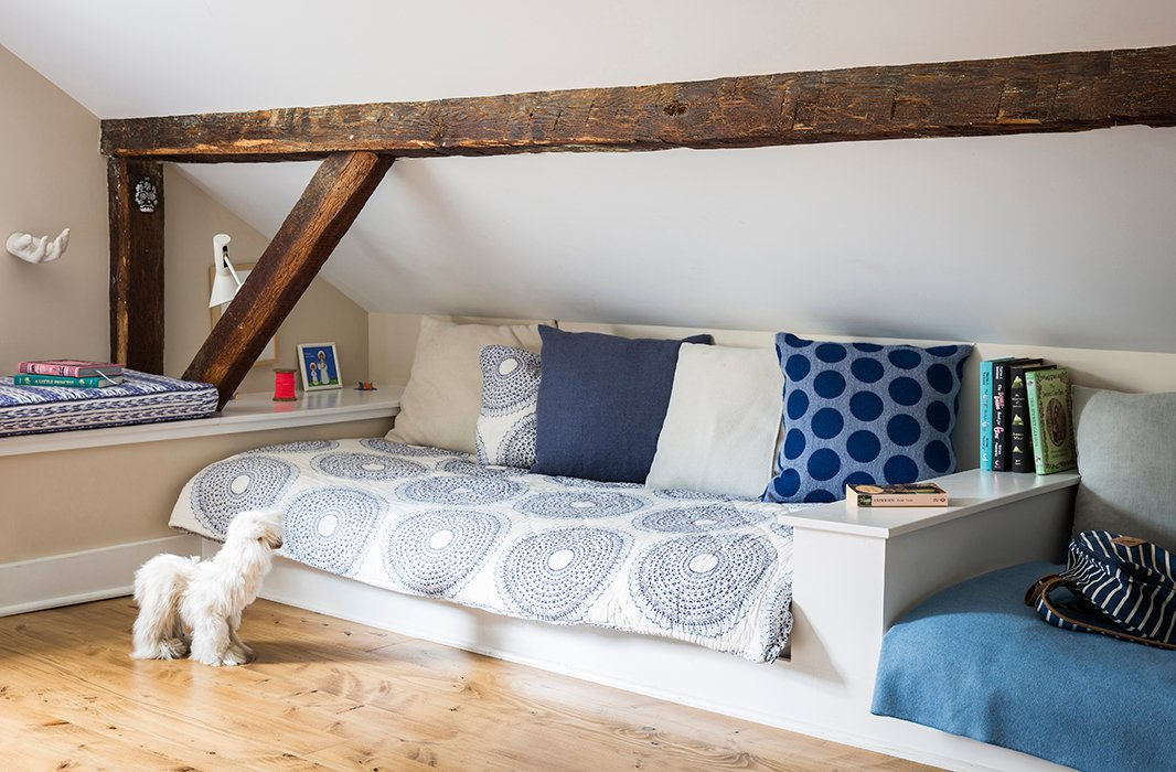 "Alicia and Daniel carved a kids' room out of the attic space, installing built-in beds and a desk. ""The kids like that room a lot,"" she says. ""We had some fabric from India, and I combined it with some of our classic throws and pillows."""