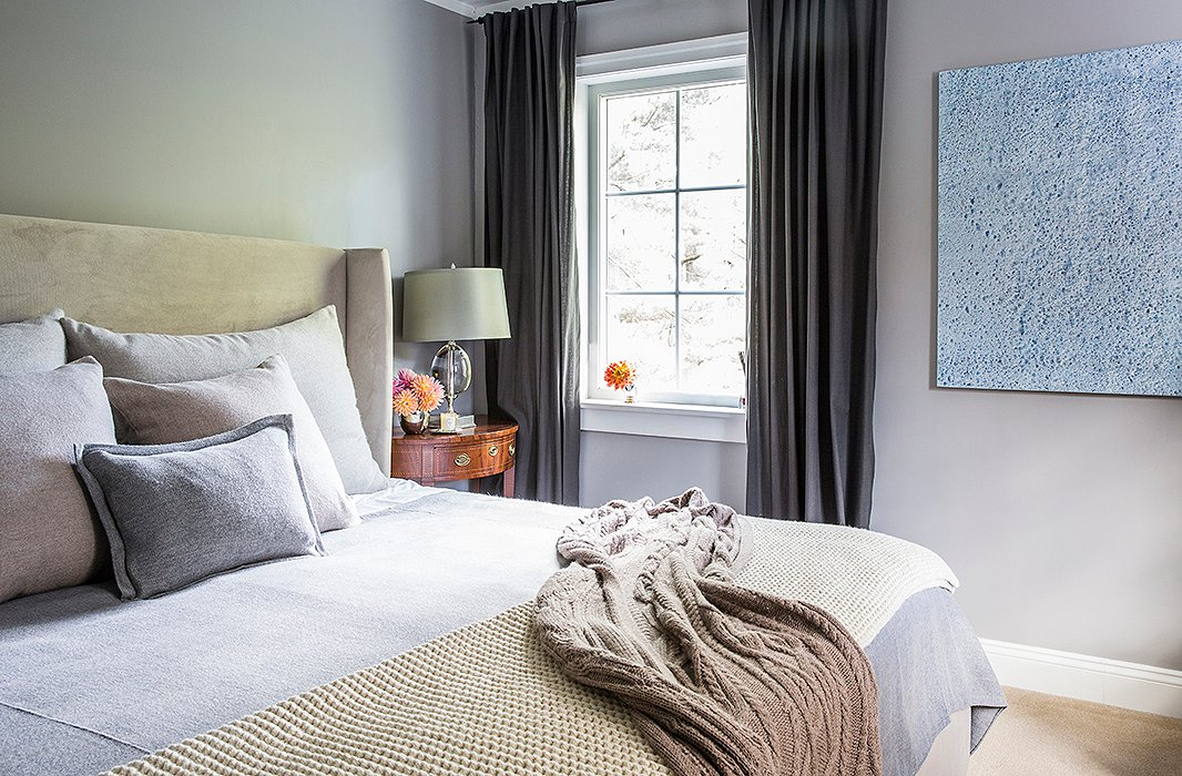 """The master bedroom is part of the addition that the couple built onto the farmhouse. Soothing shades of gray and lush textiles make the space a nightly retreat from their busy lives. """"It's really just for sleeping, because we're on the go all the time,"""" Aliciasays. """"It's not like we have time to lounge with four kids!"""""""